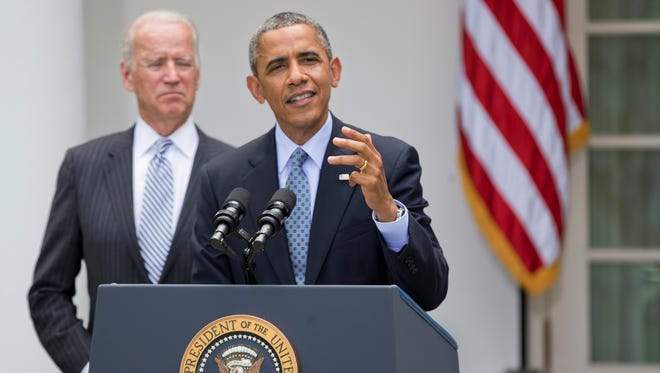 President Obama and Vice President Biden discuss immigration reform on June 30.