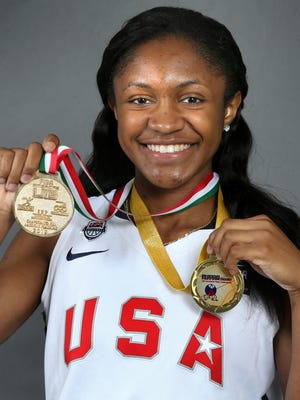 Blackman senior Crystal Dangerfield holds the two gold medals she won with Team USA.