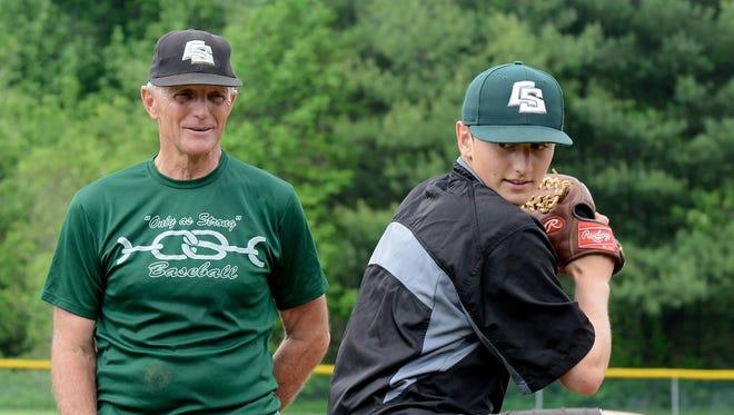 Christ School baseball coach and former Greenies pitcher Camrin Opp.