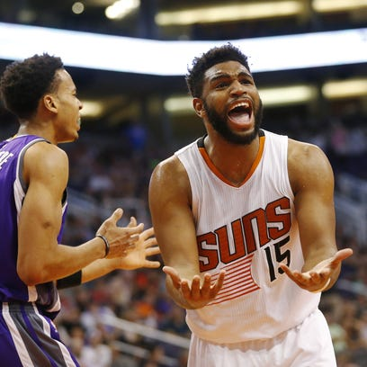 Phoenix Suns forward Alan Williams (15) argues for