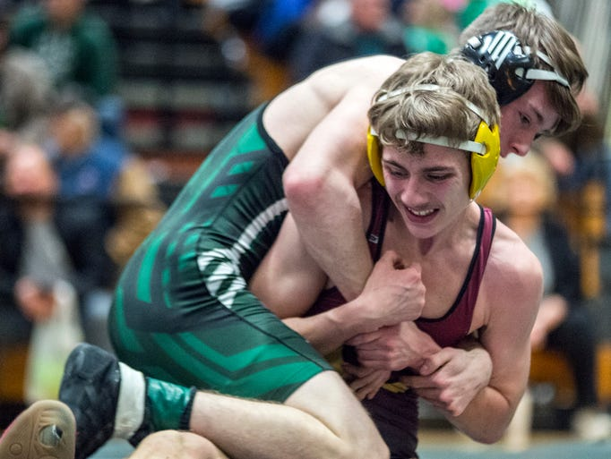 Brandon Baltz of Nathan Hale makes a reverse move on