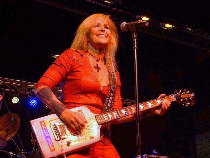 Lita Ford performs at 80's in the Park. The event was