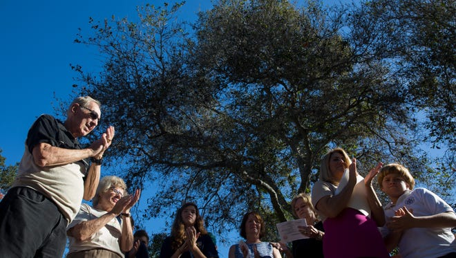 Volunteers, city officials and residents attend a dedication ceremony to recognize the largest myrtle oak in the United States at the Naples Preserve on Tuesday, Jan 17, 2017, in Naples. The Naples Preserve's myrtle oak was recognized by the American Forests, an organization that started the registry of champion trees in 1940. The tree stands 41 feet tall.