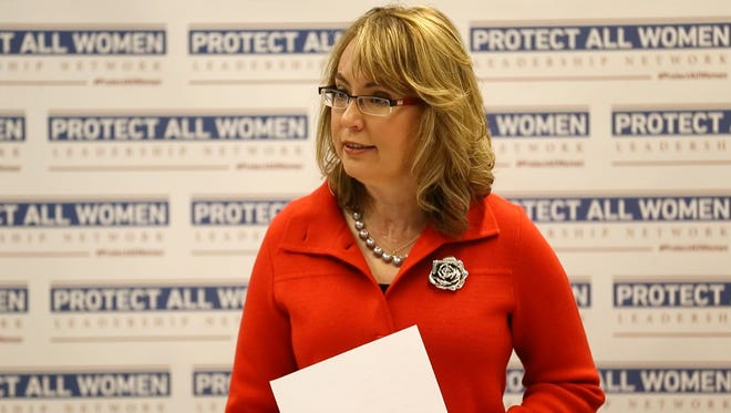 Former Congresswoman Gabrielle Giffords, the cofounder of Americans for Responsible Solutions, speaks to local women leaders, law enforcement, and domestic violence prevention advocates in Des Moines during a roundtable discussion on the need for laws that protect women and families from gun violence. Tuesday Oct. 21, 2014.