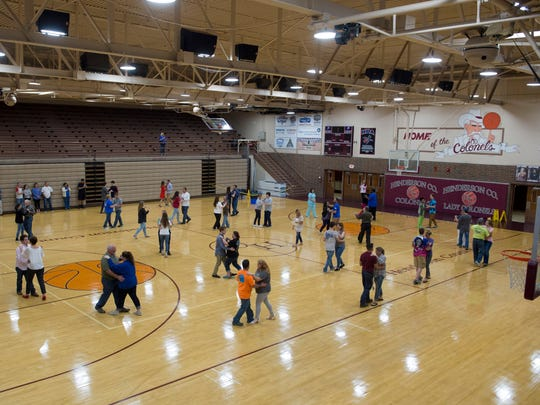 """Henderson County High School seniors and their partners, most of them family members, practice the waltz for the upcoming prom Monday evening. The 2017 prom is Saturday evening at County High. The theme is """"Rustic Romance."""""""