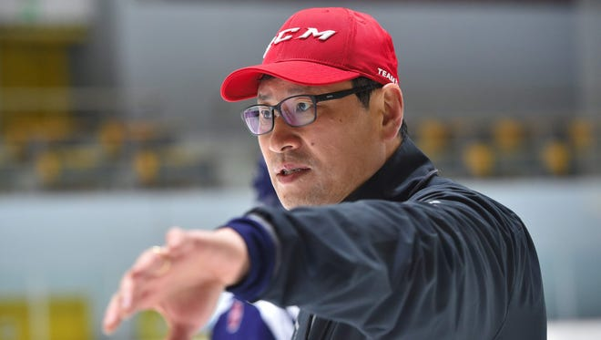 In a file photo from Feb. 14, 2017, South Korean hockey coach Jim Paek is shown during a practice session at a rink in Goyang, northwest of Seoul.