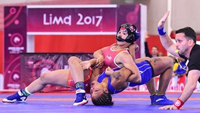 Jayden Laurent, top, competes at the Junior Pan Am Championships in Peru this past summer.