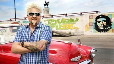 """Best known as the host of """"Diners, Drive-Ins and Dives,"""" Guy Fieri is known to travel in a red Chevy Camaro SS."""
