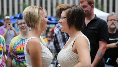 Megan Smith, left, and Lindsey Smith during a commitment ceremony on Fountain Square.