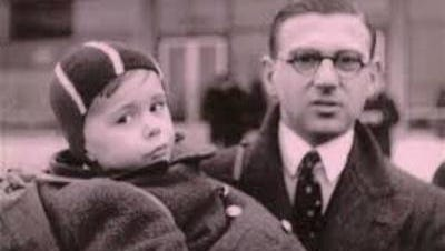 Nicholas Winton holds a young boy during a visit to Prague in 1939.