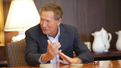 Ohio Gov. John Kasich talks with members of the Enquirer editorial board on Sept. 15, 2014.