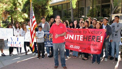 Marchers sponsored by the Phoenix Hospitality Workers union protest election-day problems