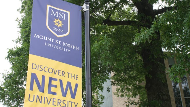 Banners with the Mount St. Joseph University name and logo hang throughout the school's Delhi Township campus.