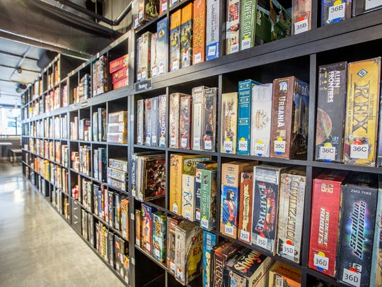 Customers can choose from hundreds of games at Snakes & Lattes board game cafe.