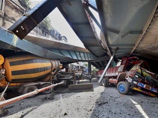 Vehicles are seen trapped under a partially collapsed