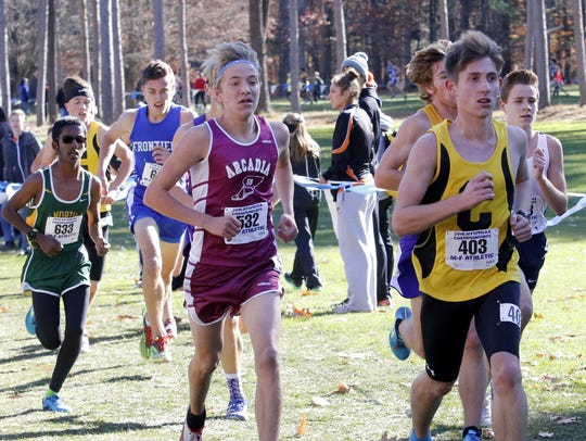 Corning's Dan Gahagan leads a pack of runners in the
