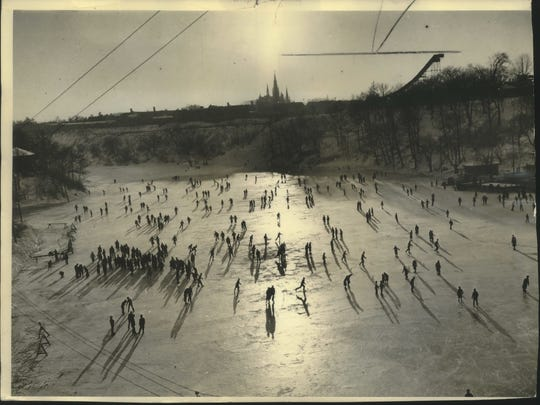 Skaters glide on the Milwaukee River at Gordon Park