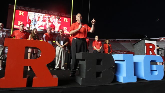 Rutgers University football head coach Kyle Flood addresses a crowd in July to celebrate the school's entry into the Big Ten conference.