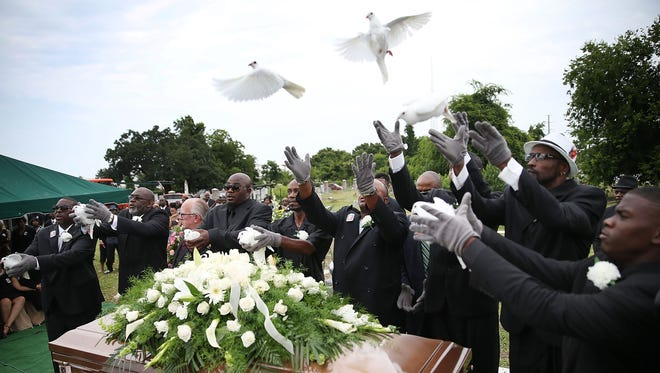 Doves are released over the casket of Ethel Lance before her burial at the AME Church cemetery on Thursday.