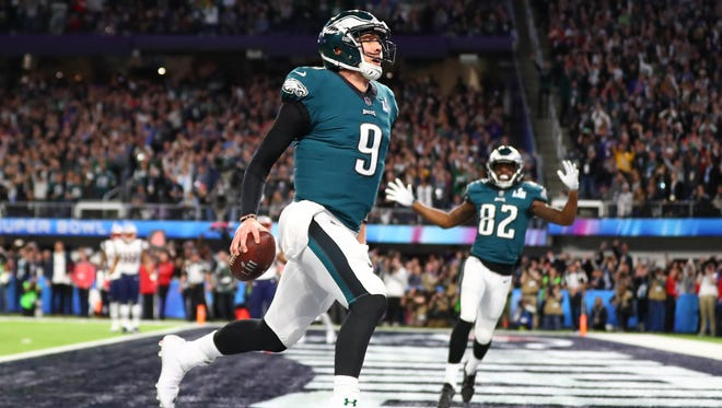 Philadelphia Eagles quarterback Nick Foles (9) catches a touchdown pass against the New England Patriots in the second quarter in Super Bowl LII at U.S. Bank Stadium.