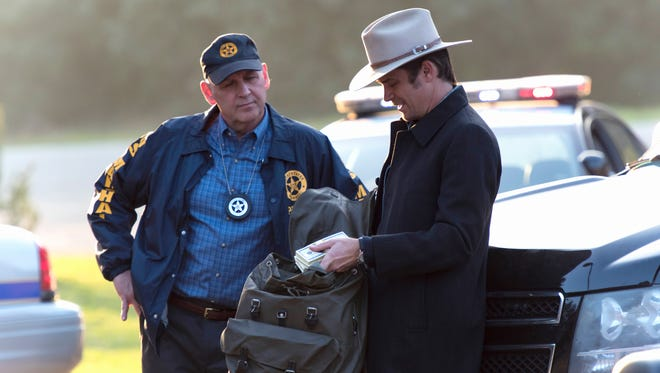 On Tuesday's episode of  'Justified,'  Nick Searcy as Chief Deputy U.S. Marshal Art Mullen, left,  and Timothy Olyphant as Deputy U.S. Marshal Raylan Givens are wrapping up the show's Season 6 run.