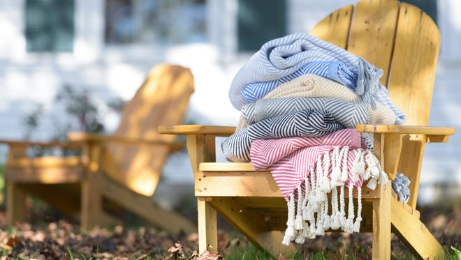 Cotton herringbone throws with hand twisted fringes can be a wonderful design element in or outdoors.