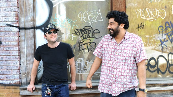 Local chefs Elliott Moss and Meherwan Irani are teaming up to open Buxton Hall which will be a pit barbecue restaurant located in the Standard Paper Sales building on Banks Ave.  5/20/14- Erin Brethauer (ebrethau@citizen-times.com)