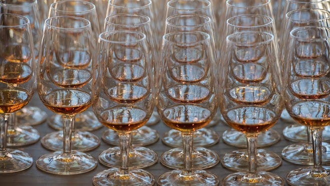 Portions of bourbon are educational materials for tasting in the Executive Bourbon Steward Course, part of the Stave & Thief Society Program at the Distilled Spirits Epicenter in downtown Louisville. Nov. 2, 2015