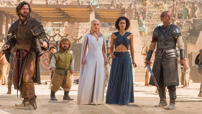 "This photo provided by HBO shows, Michiel Huisman, from left, Peter Dinklage, Emilia Clarke, Nathalie Emmanuel, and Iain Glen, in a scene from ""Game of Thrones,"" season 5."