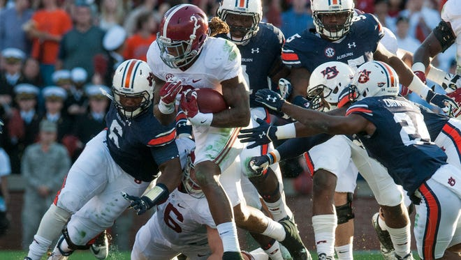 Alabama running back Derrick Henry (2) carries against Auburn during the Iron Bowl at Jordan-Hare Stadium in Auburn, Ala. on Saturday November 28, 2015. (Mickey Welsh / Montgomery Advertiser)