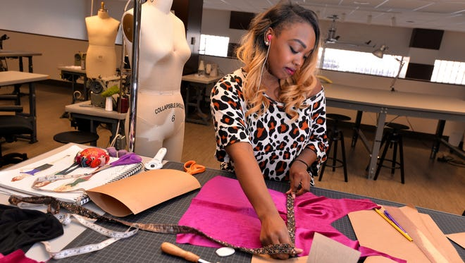 Krissy Huffman, of Krissy Huffman Designs, makes a custom blouse for a customer at The Runway inside the Knapp's Centre in downtown Lansing. The Runway was awarded $5,000 by the Lansing Economic Area Partnership to cover operational and programming costs.