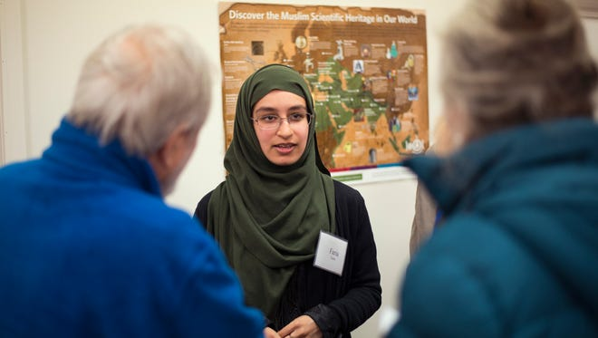23-year-old Faaria Fasih, Binghamton native now living in New York City, speaks to visitors during Saturday's open house event at the Islamic Organization of the Southern Tier in Johnson City.