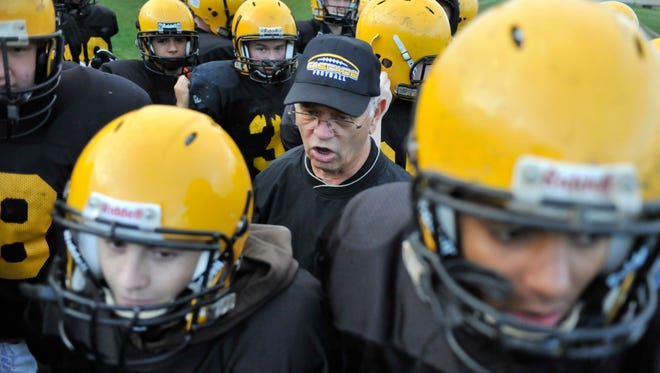 Cascade football coach Karl Elliot retired from coaching four times.