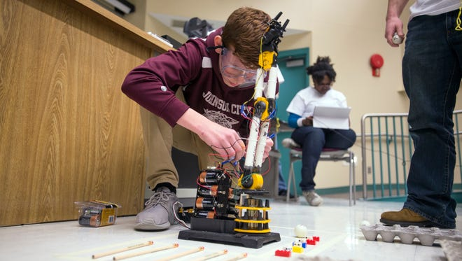 Johnson City High School student Christian Danek, 14, prepares his robotic arm for testing during the Southern Tier Science Olympiad at Binghamton University on Saturday.
