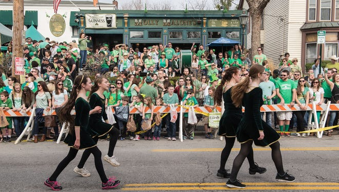 Irish dancers pas Molly Malone's in the St. Patrick's Day parade Saturday along Baxter Avenue. March. 12, 2016