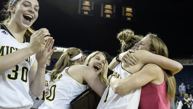 Michigan players celebrate their 77-76 victory over Temple Monday at the women's NIT quarterfinal.
