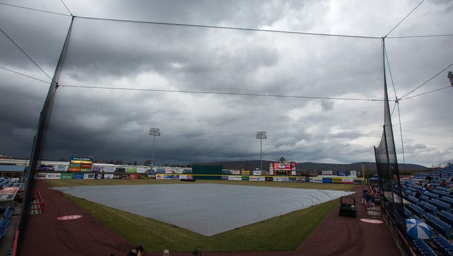 A tarp covers the field before the scheduled start time of the Binghamton Mets opening game against the New Hampshire Fisher Cats at NYSEG Stadium on Thursday, April 7, 2016. The game was postponed due to rain.