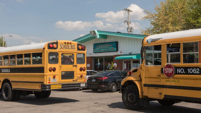 Jefferson County School buses arrive to drop off children at 8505 Terry Road, one of two child care centers operating under the name Lil' Kings &ÊQueens Child Care. April 20, 2016