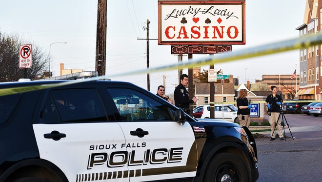 Law enforcement officers investigate the scene of a shooting that left one man dead Friday evening, April 22, 2016, outside Lucky Lady Casino in Sioux Falls.