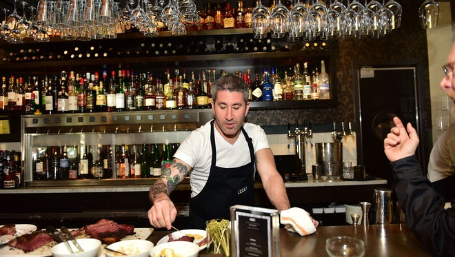 Chef Michael Solomonov talks with guest during The Impossible Reservation: Philadelphia presented by Audi on April 16 in Philadelphia.