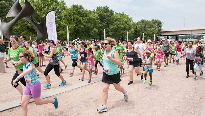 Runners and walkers begin Girls on the Run Louisville's biannual 5K Fun-Run on the Festival Plaza at Waterfront Park in 2015.