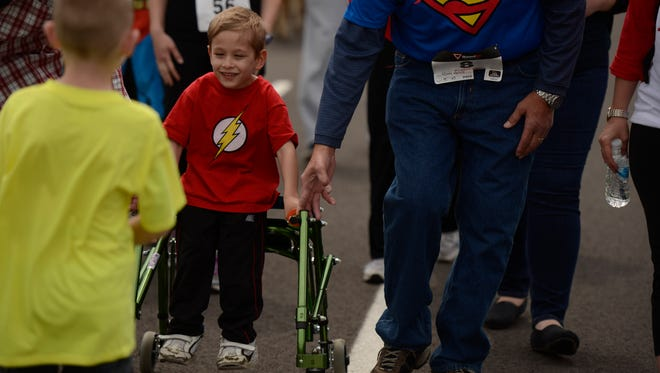Several hundred runners participated in Ryan's Superhero Run for Kali's Klub House at Hickories Park in Owego in May 2016. Many of the runners donned the capes and masks of their favorite superheroes as they ran.