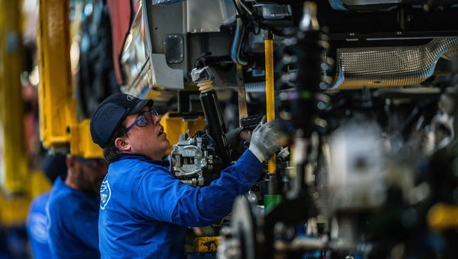 Employees work on Ford Mondeo vehicles on the production line during assembly at Ford plant in Almussafes. Spain. The United Kingdom's decision to pull out of the European Union complicates the auto business on the continent