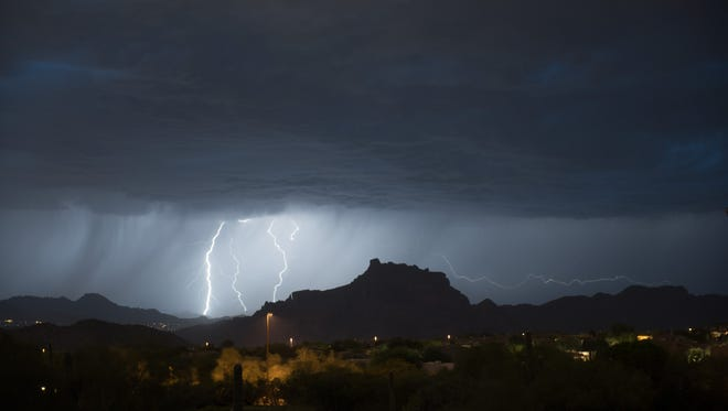 Lightning strikes near Red Mountain.