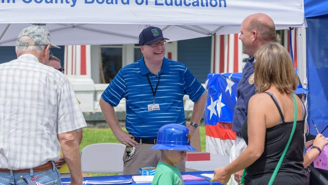 Greg Schultz, Oldham County Board of Education's new superintendent, talks with Brent Deaves, secondary director of Oldham County Schools, and Deaves' wife, Meredith.