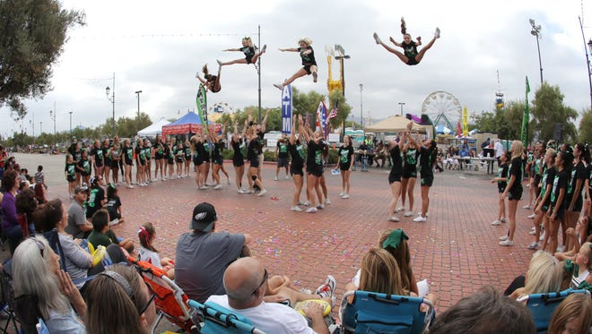 Cheer Force Simi Valley members perform in front of the crowd gathered for the 2014 Simi Valley Days Parade. This year's parade will start at 9 a.m. Saturday.