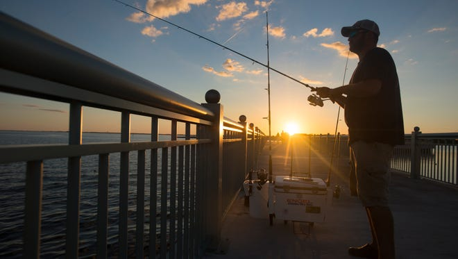 Josh Collins fishes as the sun sets at Maritime Park in Pensacola on Tuesday, October 4, 2016.