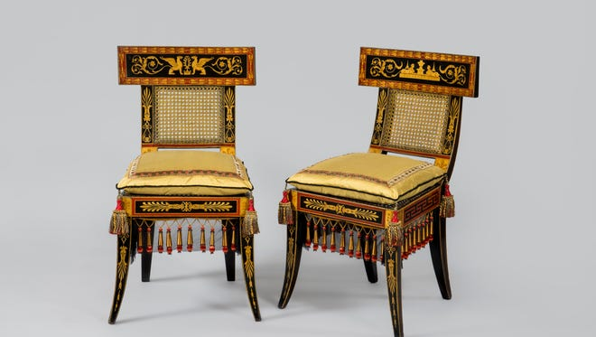 These side chairs were designed by Benjamin Henry Latrobe and decorated by George Bridgport. The Walns  commissioned Latrobe to design furniture for two drawing rooms. The chairs are basically Klismos chairs, featuring curved backrests and tapering outcurved legs
