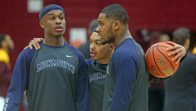 Seth Harrison/The Journal News Monmouth?s Josh James, left, stands with teammates Justin Robinson and Austin Tilghman before Friday night?s game against Iona. Monmouth's Josh James, a Stepinac graduate, left, with teammates Justin Robinson and Austin Tilghman before a game against Iona at Iona College in New Rochelle Jan. 15, 2016.