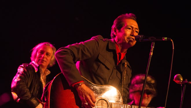 Alejandro Escovedo and Peter Buck (rear left) perform at Turner Ballroom Thursday night.  Credit: Melissa Miller photo